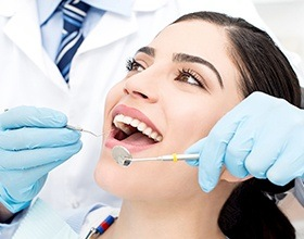 Woman receiving dental treatment