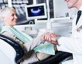 elderly woman at a dental implant consultation