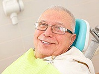 older man smiling in the dental treatment chair