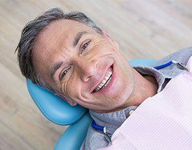 older man smiling at the dentist's office