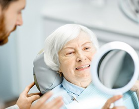 woman admiring her dentures