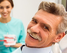 Smiling older man in dental chair