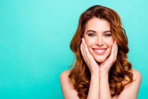 Woman with beautiful teeth after visiting cosmetic dentist in Boca Raton