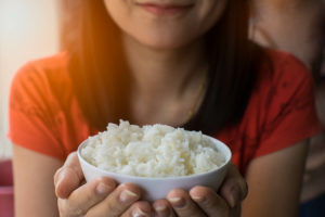 Bowl of rice, which can help maintain white teeth