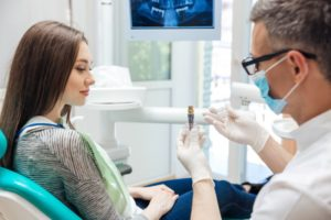Dentist explaining surgery for dental implants in Boca Raton