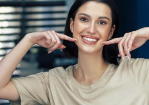 Showing off smile after visiting cosmetic dentist in Boca Raton
