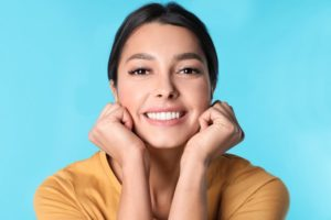 Young woman with beautiful smile after visiting cosmetic dentist Boca Raton